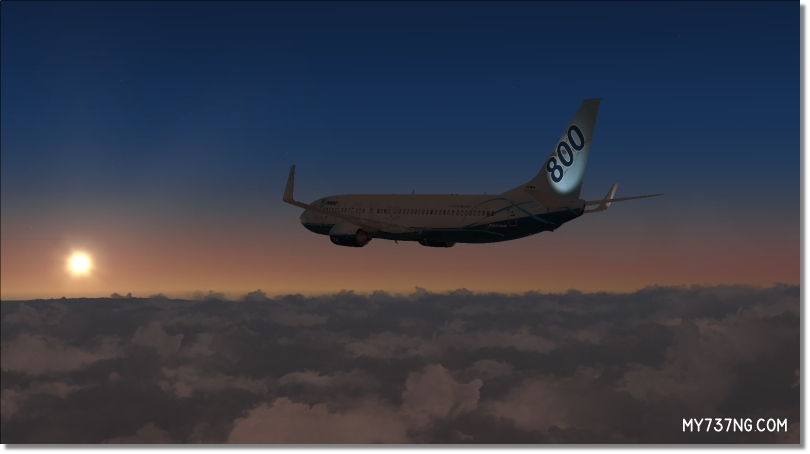My PMDG 737-800 NGX in cruise flight with visible exterior tail and winglet lighting.