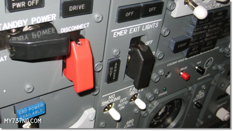 Custom EMER EXIT LIGHTS switch guard on CPFlight forward overhead panel.